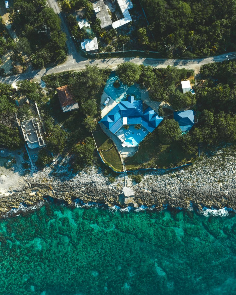 House and clear sea drone photography
