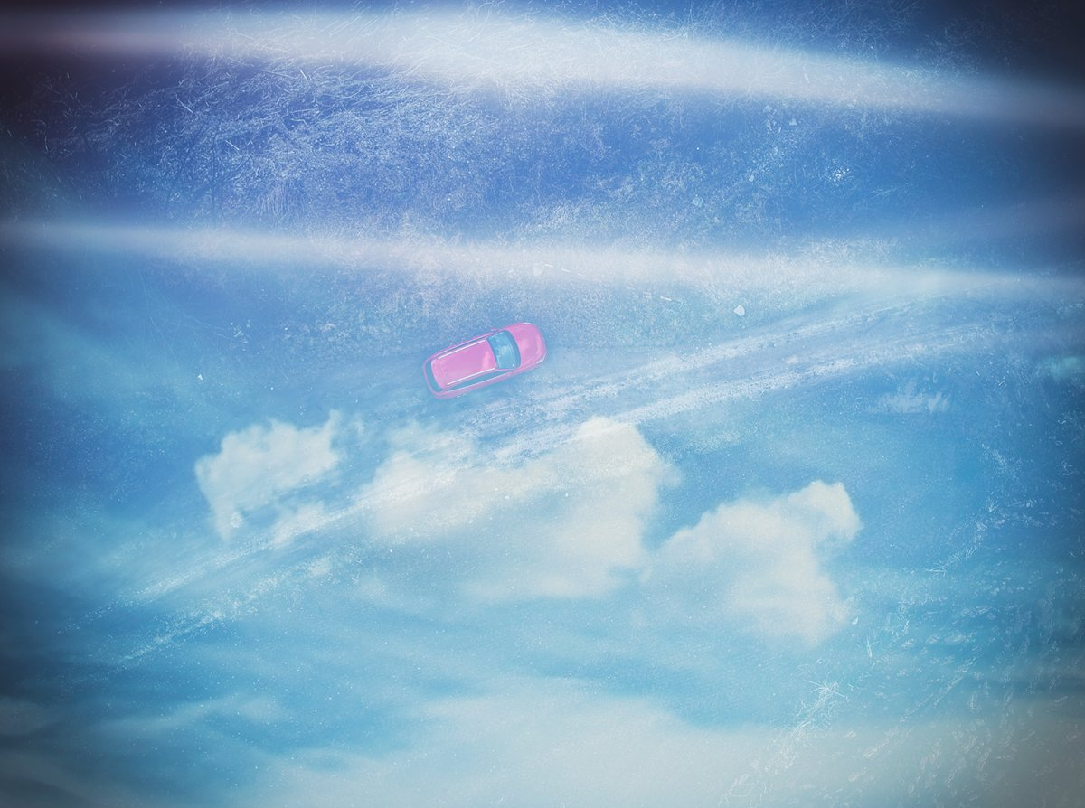 Clouds and car from drone